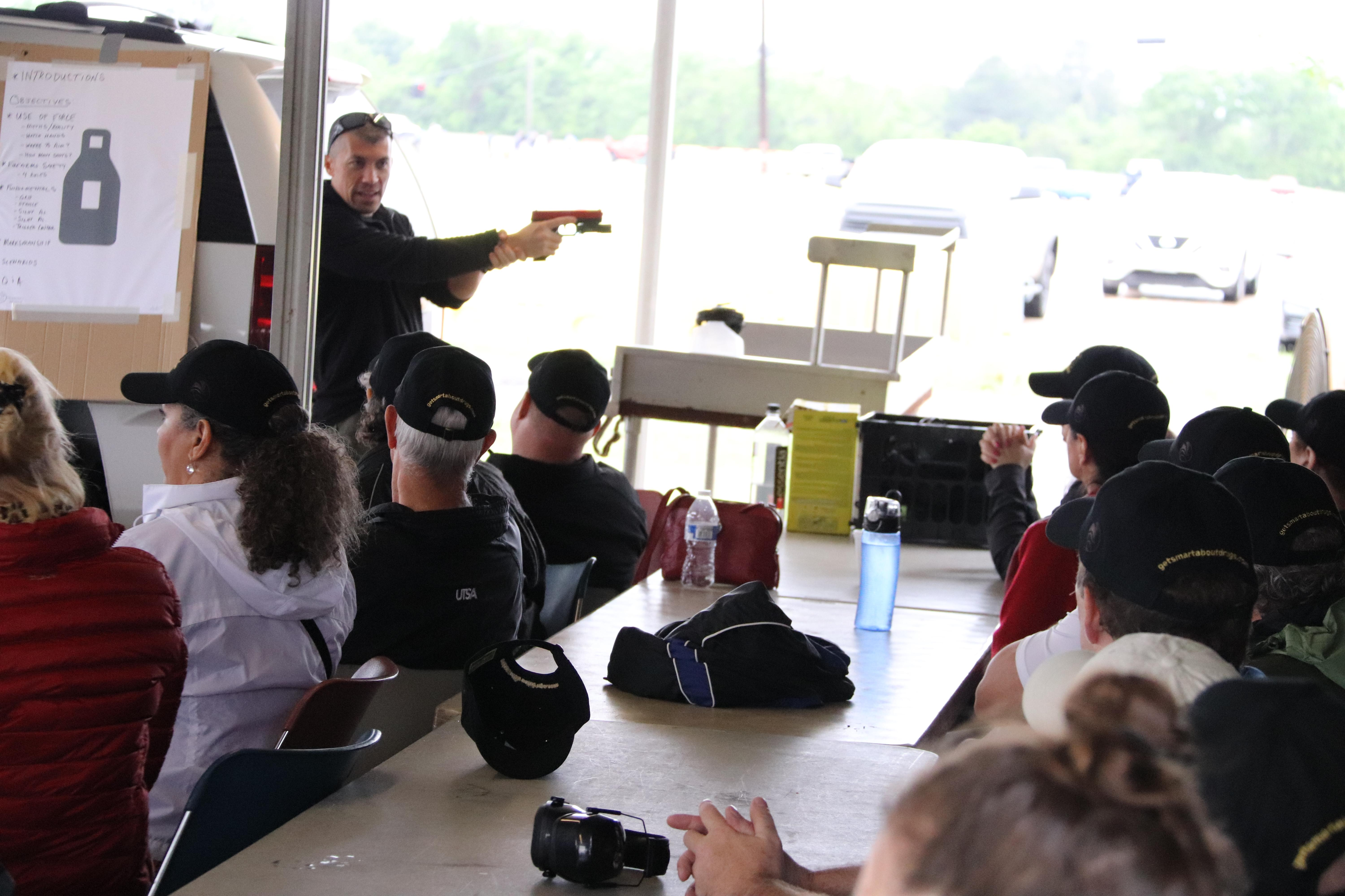 A DEA Special Agent gives a firearms overview to a 2017 Citizens Academy Class