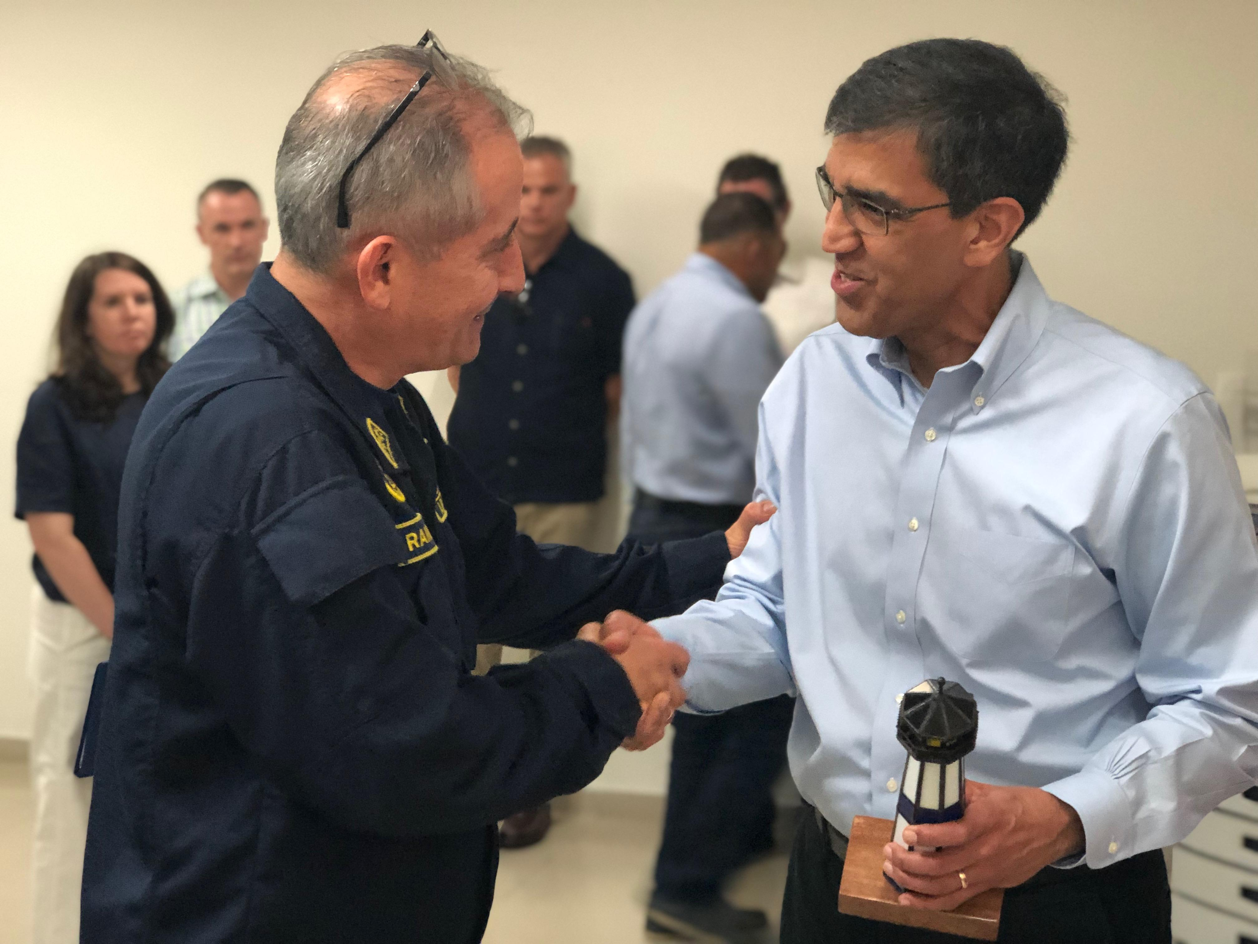 Acting Administrator receives a lighthouse from Admiral Ramirez that was handcrafted by a Colombian Navy Officer.