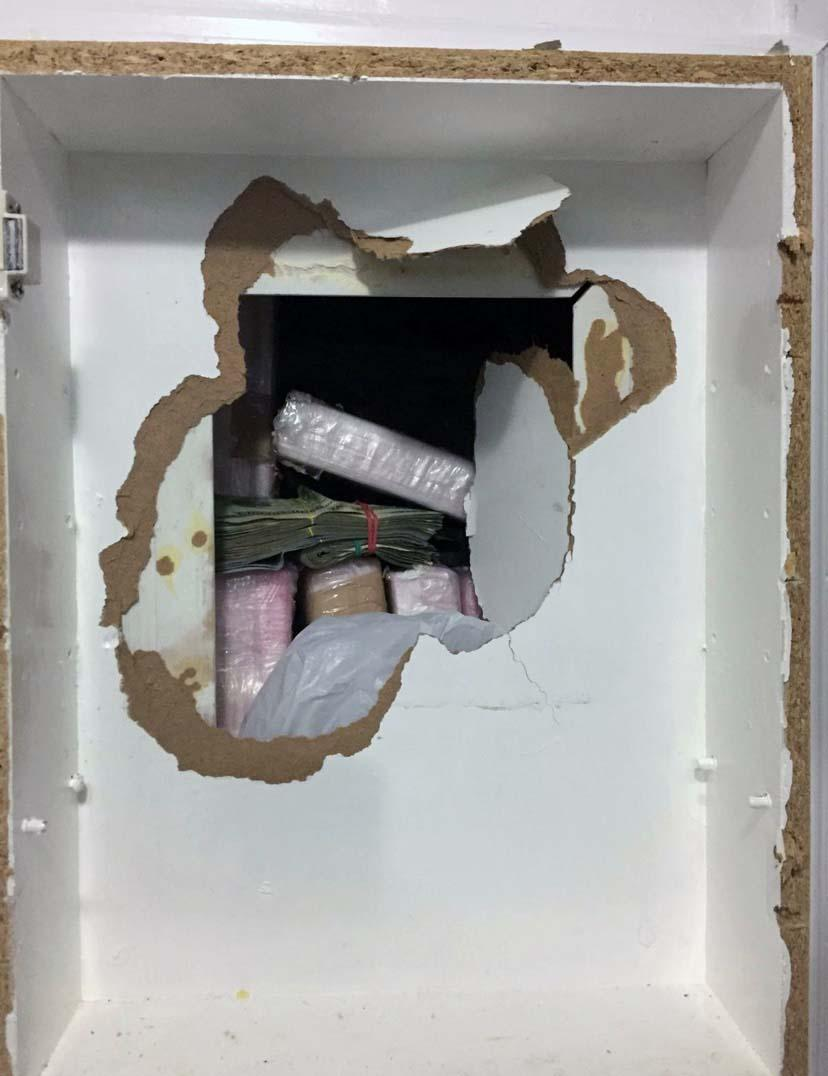 Trafficking organization used concealed compartment behind bathroom medicine cabinet