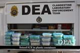 Seized ICE in plastic containers.