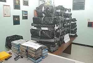 Close to 560 kilograms of cocaine and pistol seized in Fajardo, PR by DEA, ICE and PRPD agents.
