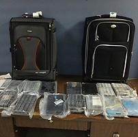 Suitcases and cocaine seized at the Luis Munoz Marin International Airport.