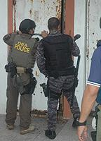 DEA and PRPD agents execute a search warrant at a residence in La Perla.