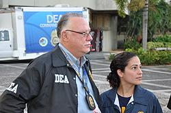SAC Javier Peña and USPIS Supervisor Delany De Leon answer questions from the media