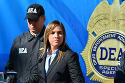 Assistant U.S. Attorney Teresa Zapata (R) and Special Agent Eddie Rosado (L), announce to the news media the indictment of 63 members of the drug trafficking organization lead by brothers Edwin and Edward Santiago during a news conference.