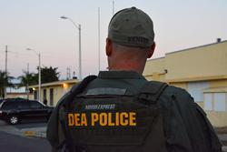 DEA Special Agent provides perimeter security during arrest operation at La Ceiba Public Housing Project in Ponce, Puerto Rico
