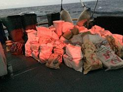 USCG retrieved 43 packages of suspected contraband aboard a Finnish-flagged sailing vessel in the Caribbean Sea.