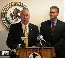DEA Special Agent in Charge Jack Riley (at podium) and Wisconsin Attorney General J.B. Van Hollen address the media.