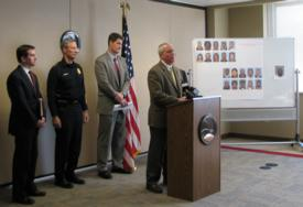 L-R: U.S. Attorney for the Eastern District of Wisconsin James Santelle, Chief of Milwaukee Police Department Edward Flynn, Milwaukee County District Attorney John Chisholm, and SAC Jack Riley (at podium).
