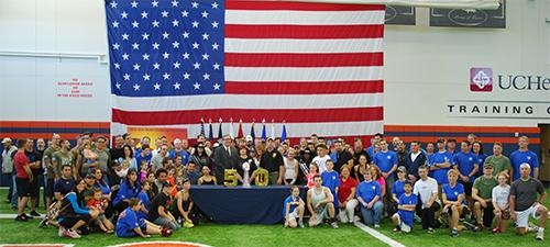 Participants at the new Denver Broncos practice facility with the Lombardi Trophy.