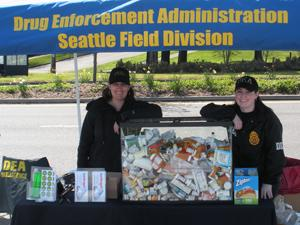 Drive-up collection site in West Seattle with drugs collected from three cars.