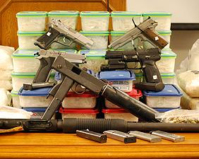 Meth, heroin, guns and money seized by Las Vegas DEA HIDTA task force.