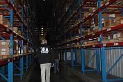 DEA Investigators reviewing inventory in the distribution center.