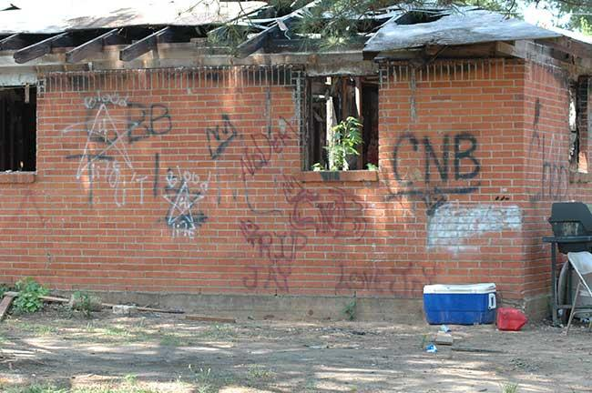 "An area in Crenshaw Village in Elmore County, Alabama where the ""Care Nothin' 'Bout It"" Gang (CNB) marked the buildings with graffiti."