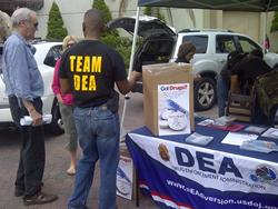 DEA employees in New Orleans, LA taking back drugs on a previous prescription drug take-back day.