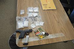 Methamphetamine and two handguns seized from Jesus Valenzuela.