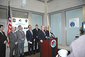 ASAC James R. Burns Jr. at the podium. L-R (background): RAC Dale Kasprzyk, Gary Baldauf Regional Director Medicaid Fraud, U.S. Attorney William J. Hochul, Jr., Niagara County Sherriff James R. Votour, Niagara Falls Chief of Police John R. Chella.