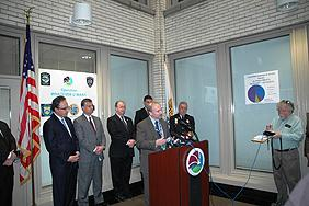 RAC Dale Kasprzyk at the podium. L-R (background): U.S. Attorney William J. Hochul, Jr., Gary Baldauf Regional Director Medicaid Fraud, ASAC James R. Burns Jr., Niagara County Sherriff James R. Votour, Niagara Falls Chief of Police John R. Chella.