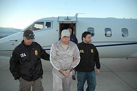DEA agents escort Esteban Rodriguez-Olivera upon his arrival in the U.S.