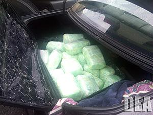 Suitcase holding meth and heroin in vehicle trunk.