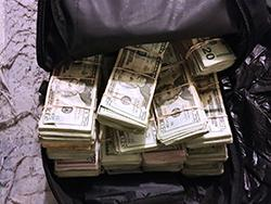 Money seized during an arrest involving 52kg of cocaine.