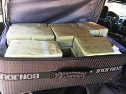 Suitcase of bricks filled with heroin