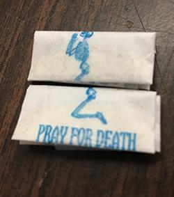 "A court authorized search yielded cash and 215 glassine envelopes of suspected heroin/fentanyl stamped with an image of a kneeling skeleton and the brand name ""Pray for Death."""