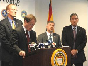 L-R: United States Attorney Dennis Burke at podium; ATF SAC Bill Newell; ICE SAC Mathew Allen; DEA ASAC Chris Feistl.