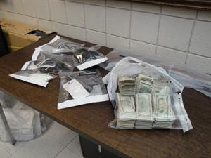 Weapons and money seized.