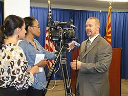 DEA Acting SAC Coleman with print and radio reporters.