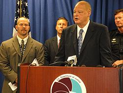 Arizona Attorney General Tom Horne at the podium; L-R: DEA Acting SAC Coleman, FBI SAC James Turgal and Avondale Police Department Chief Kevin Kotsur.