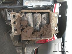 Bundles of cocaine packed inside a hidden compartment underneath vehicle headlights