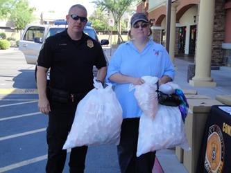Glendale PD Officer Andrew Lynes and local resident at collection site in Glendale, AZ.