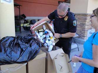 Glendale PD Officer filling collection box