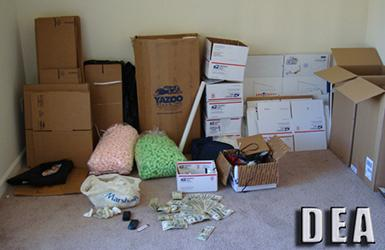 ) Packaging material at a Phoenix residence where agents recovered  over 171 pounds of marijuana, currency and 3 weapons.