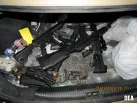 Various weapons seized from a stash house.