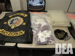 Alma Motorcycle Club Member's leather vest; multiple packages of steroid capsules; encapsulating machines; knuckle rings.