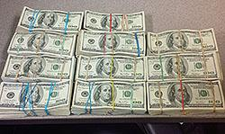 Bundles of cash seized during the operation.