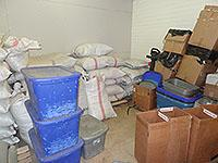 Photos of spice manufacturing at various stages.  Cement mixers, bulk damiana leaf in bags and bins.