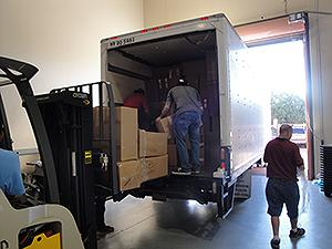 Personnel load a semi-truck with collected prescription drugs from DEA's National Prescription Drug Take Back Day.
