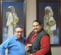 Yakama Nation Tribal Council Chairman Harry Smiskin and award recipient Captain James Shike III displaying the first DEA Tribal Narcotics Officer of the Year Award.