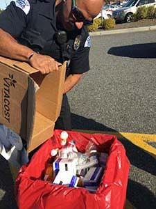 Pasco, Washington law enforcement officer disposing of prescription medicines at Take Back Saturday, October 22, 2016