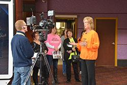 A local television station interviews Gee Vigna, a mother who lost her daughter to a heroin overdose.